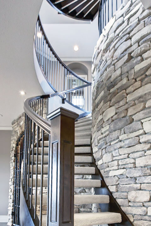 Curved Staircase Around Stone Feature Wall