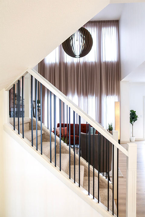 Grouped Spindles in an Open To Below Great Room
