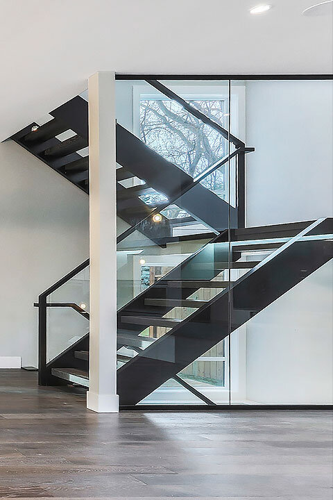 New Home with Glass Wall Staircase